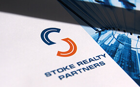Stoke Realty Partners. Logo Design. Graphic Design. Presentation Folder Development.