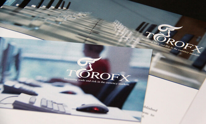 photographed marketing materials of ToroFX